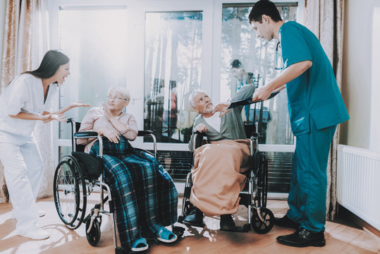 Medical Workers . Argue with Elderly Couple .