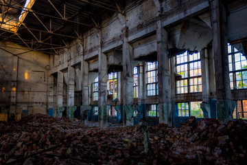 Abandoned rusted ruined industrial hall waiting for demolition. Former Voronezh excavator plant