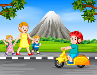 the boy driving the motorcycle when the woman and her children walk  on the road