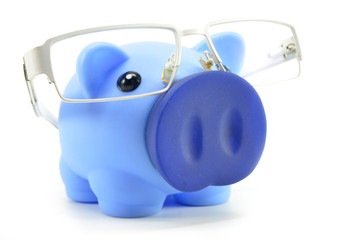 Blue piggy bank with glasses