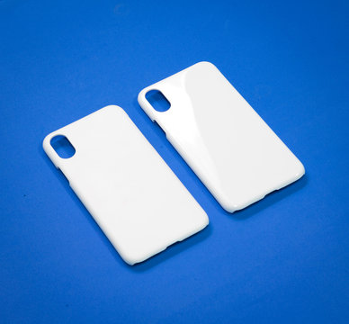 White mobile case on blue background. Smart phone cover for your design.
