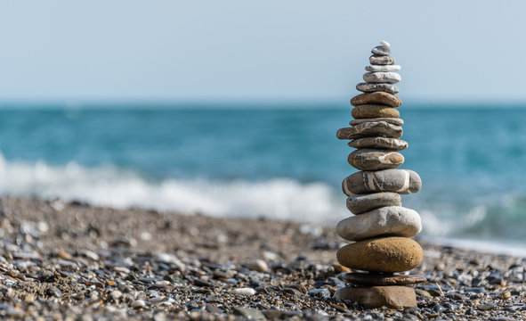 Stone Stack on a Beach in Italy