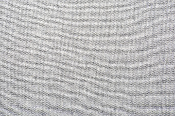 The texture of the knitted gray fabric for the background