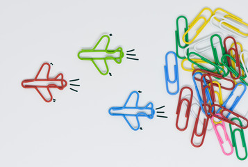 Business concept for group of stacked paperclip with group of plane paperclip is point to another direction as a team leadership and difference thinking