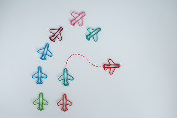 Business concept for group of plan paperclip with another one green plane paperclip is point to another direction as a team individual leadership - Flay lay