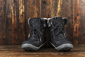 winter boots on a wooden background