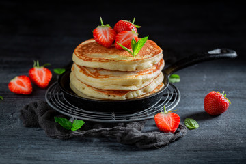 Delicious american pancakes for breakfast on dark table