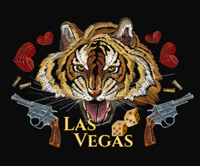Wild west embroidery tiger head, heart and old revolvers. Las Vegas slogan. Casino art, western concept. Template for clothes, t-shirt design. Embroidery tiger and guns