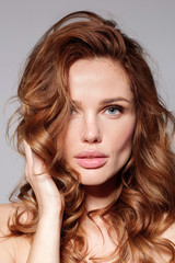 Fototapeta Woman with natural make up and curly long hair