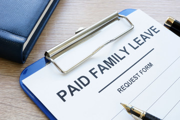 Paid family leave form in clipboard and note pad. Wall mural