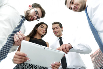 closeup of business team looking at digital tablet.