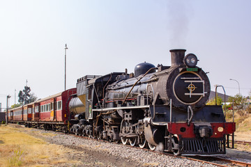old steam locomotive in station