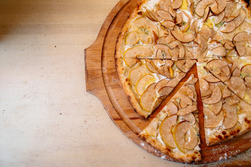 pizza with pear and gargantzolla on a wooden board
