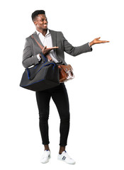Full body of African american business man traveling with suitcases presenting and inviting to come on white background