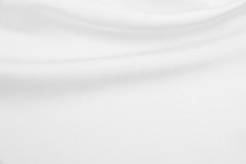 Smooth elegant white silk or satin luxury cloth texture as wedding background. Luxurious background design