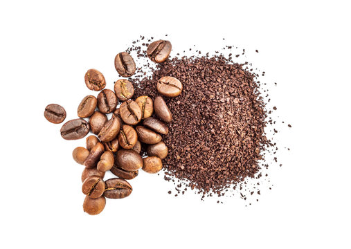 Pile of ground coffee and coffee beans on white.