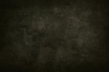 dark green stained grungy background or texture