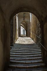 Fototapeta Narrow streets and cobblestone stairway in Pitigliano, Tuscany
