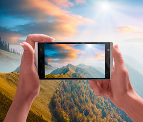 Carpathian mountain valley on a screen of smartphone