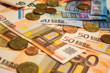 A composition of euro banknotes and coins providing great options to be used for illustrating subjects as business, banking, media, presentations etc.