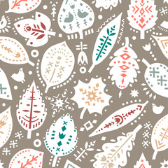 Vector seamless pattern of autumn leaves with ethnic ornaments.