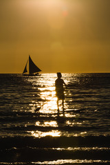 Silhouette of a man practicing stand-up paddle