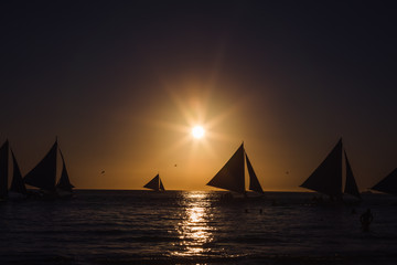One outrigger sailboat on the horizon