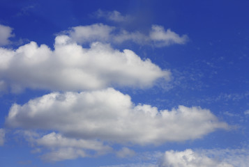 Idyllic white cloud on blue sky. Cloudscape background with fluffy cloud on blue summer sky wallpaper texture