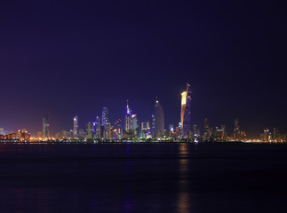 The Skyline Of Kuwait City At Night Glitters With Light
