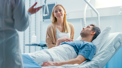 In the Hospital, Patient Lying in Bed, his Wife Sitting Beside, They Listen to Doctor's Explanations. Love and Care Concept.
