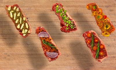 Conceptual floating view of vegetable seasoned New York Strips