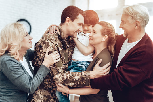 A Man Returns From The Military. Family Meeting.