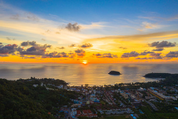 aerial panorama sunrise at Kata beach close to Karon beach in the middle of two beach has Pu island.