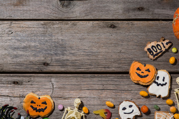 halloween pumpkins, spiders, horror stories and more on a wooden background