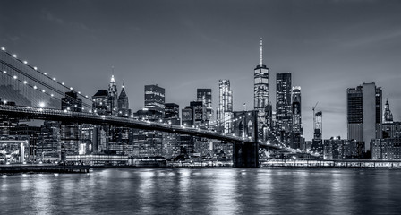 Autocollant pour porte Lieux connus d Amérique Panorama new york city at night in monochrome blue tonality