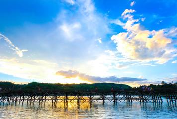 Sunset on the Uttanom Bridge in Thailand, Kanchanaburi,Thailand's Top Tourist Attractions Mon Bridge