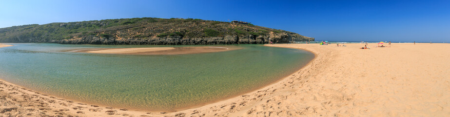 Panoramic veiw on a lagoon on the beach Praia Amoreira at the West Coast of Portugal near Aljezur