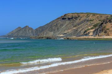 Mountain shaped as a lying man on the beach Praia Amoreira near Aljezur on the west coast of Portugal