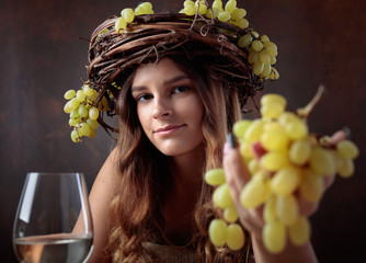 Young beautiful woman with glass of white wine.