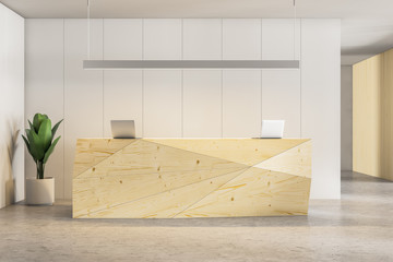 Wooden office reception desk with laptops
