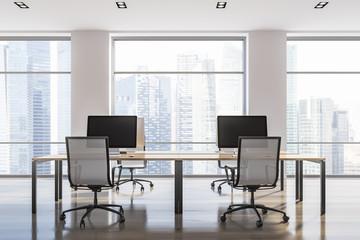 White loft office interior, computer monitors