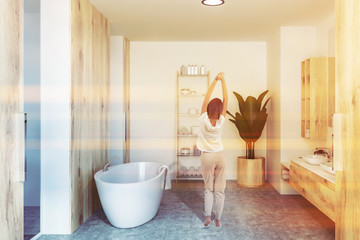 White bathroom interior, sink and tub, woman