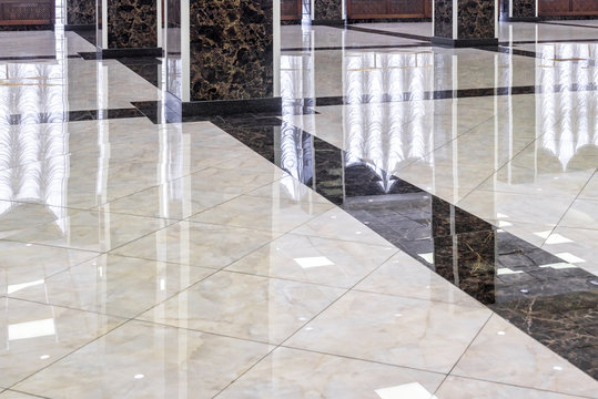 Clean shiny marble floor in commercial office, cleaning service concept