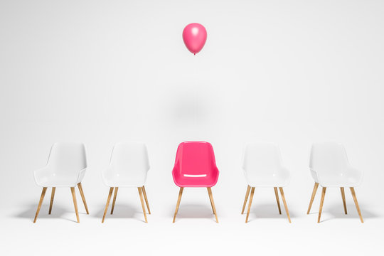 White chairs row, pink chair with balloon, choice