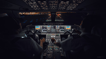 Modern Aircraft Cockpit Night Landing