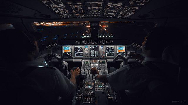 Modern Aircraft Cockpit Night Landing