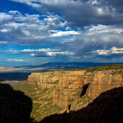 Sunset light on the steep stone cliffs of Monument Canyon in Colorado National Monument