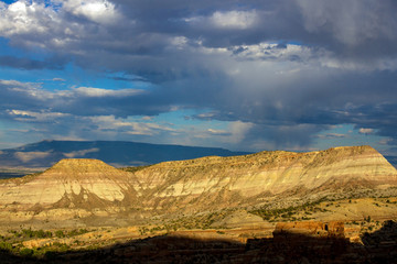 Sunset light on the steep, sloping stone cliffs of Monument Canyon in Colorado National Monument
