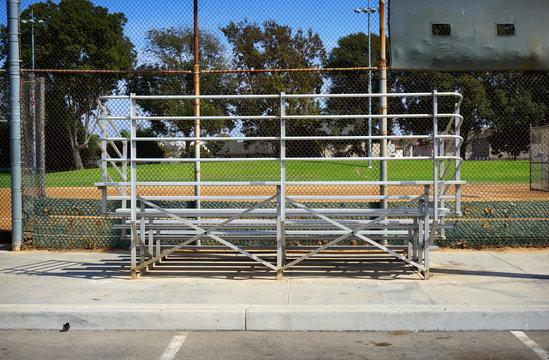 empty bleachers at baseball softball field