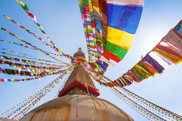 In de dag Historisch geb. Boudhanath stupa with colorful prayer flags, Buddha eyes and golden mandala in Kathmandu, Nepal, most famous Tibetan buddhism symbol among Nepalese temples, World Heritage Site